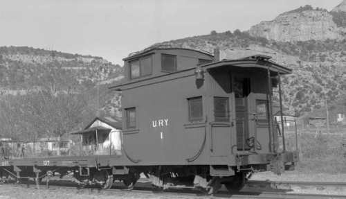 This picture shows a caboose body that has been shortened to provide more flatcar deck work space, and I like that, as well as the fact that it gives the car some unique character.