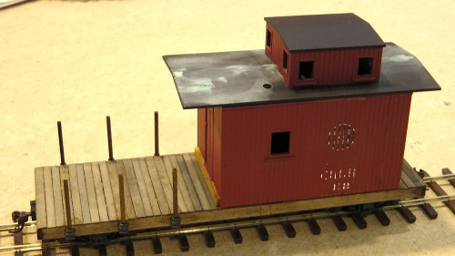 I decided not to use the roof walks for two reasons.  On one end of the caboose body, you couldn't steps across to the next car, anyway.  Roof walks were for brakemen to get to the brakes on boxcars, which were mounted above the roof line; the brake here is accessible on the back platform.