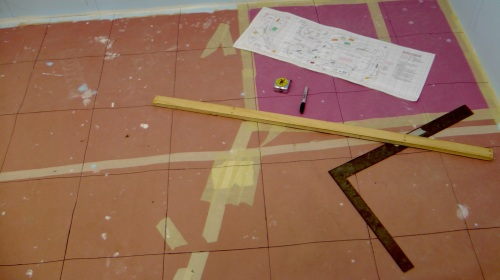 The first step is to grid the construction paper I still have taped to the floor.  This grid of one foot sqau