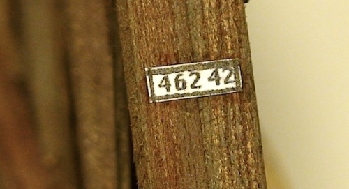 "I finally found a photo that was clear enough to read the numbers on the plate, and then I figured out that it was a milepost marker.  Mine pictured here is 1/16th of an inch tall and 3/16th of an inch wide.  At the time, I think I interpreted the ""42"" on the end as the miles to Silverton from this point, but I think now that it is more likely the bridge number. Railroads used numbers rather than names to identify their bridges."