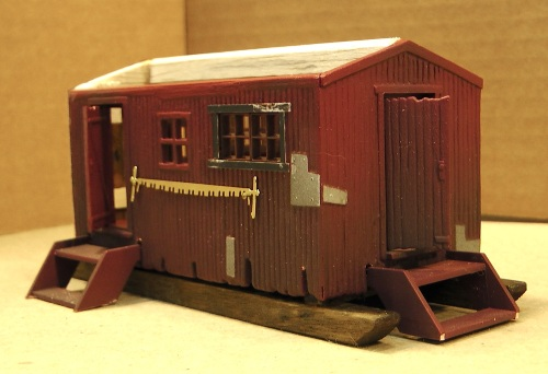 I wanted my saw filer's cabin to be similar to my other lumber camp buildings, so I used hald of a Bachmann's lumber camp car.
