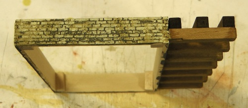 Here is the foundation with a couple of slightly different colors dry brushed on to the bricks.