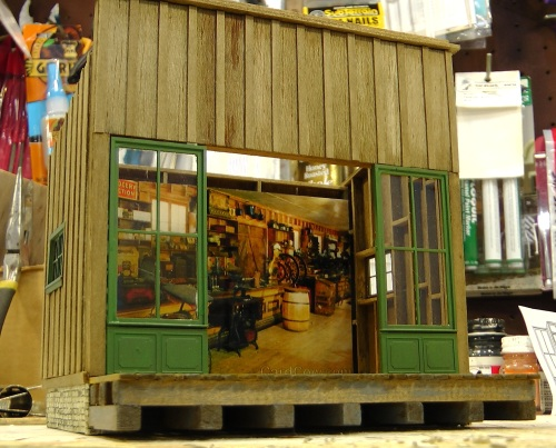 "I got the photo from Google Images, by searching for ""old stores"".  The perspective is a little off, but the colors are nice. on the photo at the back of the store"