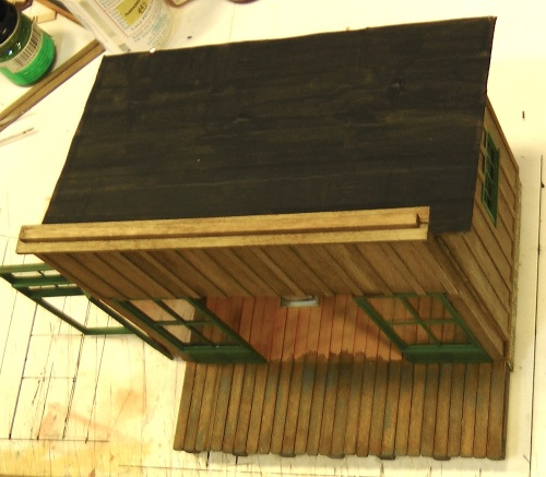 I also went for the easy solution to the roofing material.  Masking tape strips painted black do a pretty good job of simulating tar paper roofing, and they only take a couple of minutes to apply.