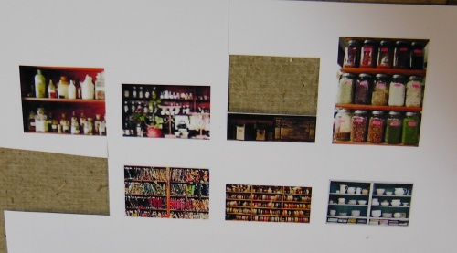 I went to Google Images, and pulled out some old store shelf photos.  Then I reduced them to the actual width of my shelf unit, 1 and 1/4 inches, and printed them on photo paper.  I selected ones I thought worked best for this particular set of shelves.