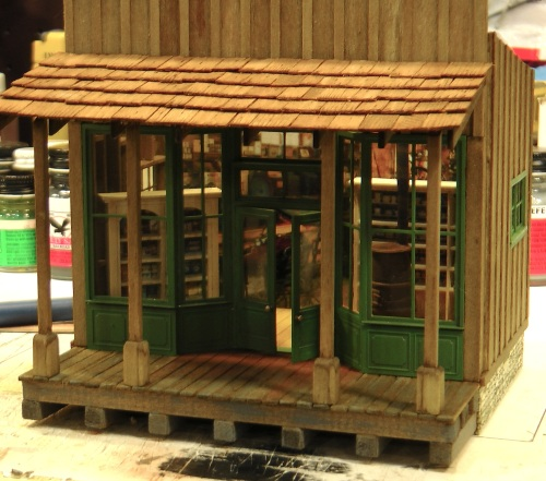 The shingled roof will sit on the header and the four posts in front.