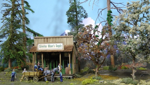 The photo set-up also features my recently completed Silverton Miner's Supply store, and a few of my deciduous trees made from Colorado open range bush armatures.