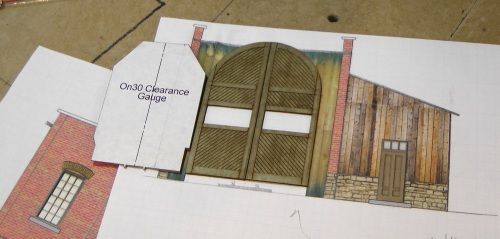 Unfortunately, it is too short for the O-Scale clearance gauge.  All was not lost, however, as I can use the shorter door on an engine house that only needs to accommodate Porters.  I sent back to Rusty Rails Rick, and got the taller door