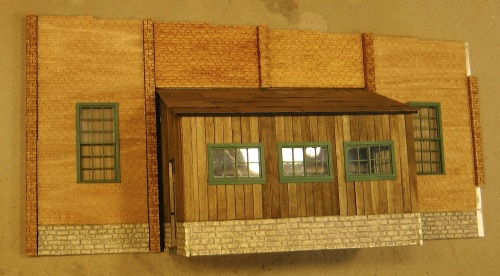 Here is the nearly completed wall that will face the aisle on my layout.  I decided that the other wall, which will not show, will just be rendered in plain black.  The thought of putting in four more windows that no one would ever see was just too much for me!