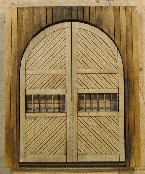 """Front wall with new taller doors.  Wood is weathered with """"soot"""" colored weathering powders."""