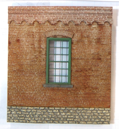 I painted the brickwork using the technique suggested by the manufacturer.  It involves the use of weathering powders dissolved in 91% isopropyl alcohol.  The first coat gives the brickwork color, the second thinner coat with a very light gray powder, settles in the recesses and gives the suggestion of mortat between the bricks.