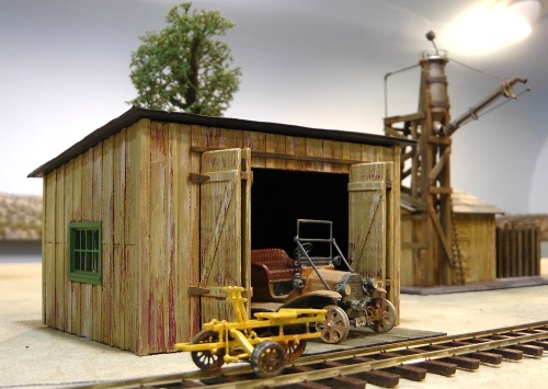 I used the same colors and dry brushing technique on the shed as I used on the sand house in the background.  This will give the buildings the feeling that they belong to the same railroad.