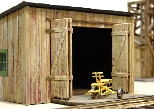 I debated about what kind of doors to use on my shed.  If I did two full swinging doors, they would have stuck out too far towards the track.