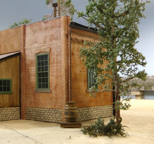 I decided to put a gutter on the rear of the engine house with a downspout and rain barrel.