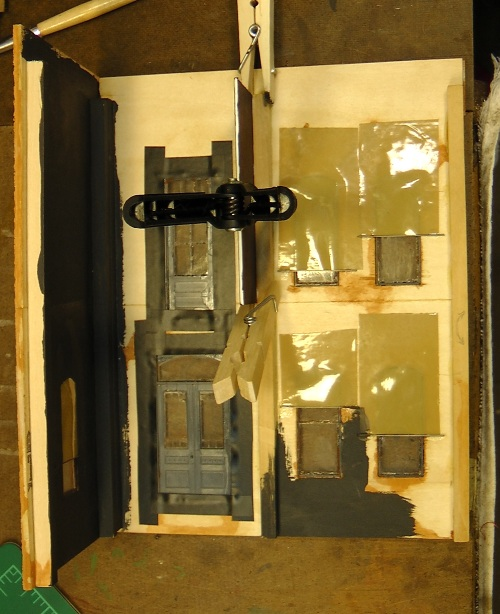 On the upper floor, I put a piece of black card stock between the balcony door which is at the end of the hallway, and the two windows of the bedroom,