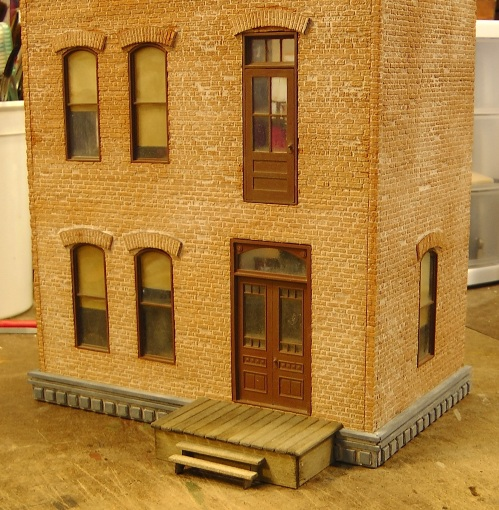 One thing I learned about Monster Model & Laserworks laser cut brick sheet is that you do not want to stain it piecemeal like I did with my engine house.  This time I was more patient, and prepared a bottle of the weathering chalk and isopropyl alcohol mixture