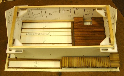 Next I cut the walls from matte board, and built the raised interior floor of the freight area.