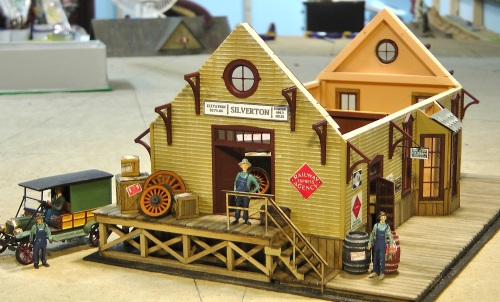 This end of the depot is pretty well detailed in this photo.  I've written before about my methods for creating shipping crates and labels, so I won't go into that again.  I found some old signs amidst my N-scale stuff for a D&RG shipping service, so I included