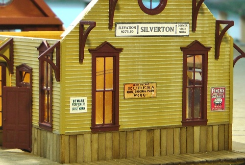 Here are a few signs on the other end of the depot.  Signs and figures and lighting really make your structures come to life.