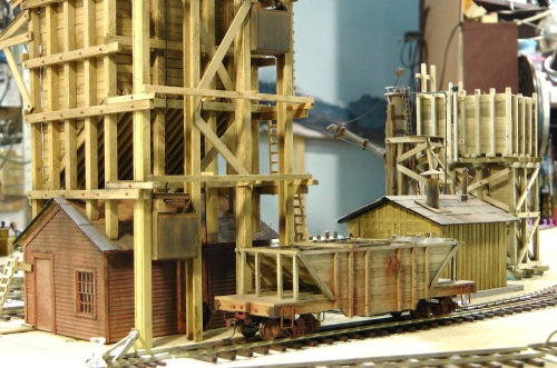 These scratch-built drop bottom coal gondolas will deliver coal through between the tracks grating.