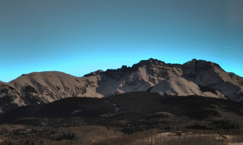 Closer to sunrise, with some light falling on the mountains.