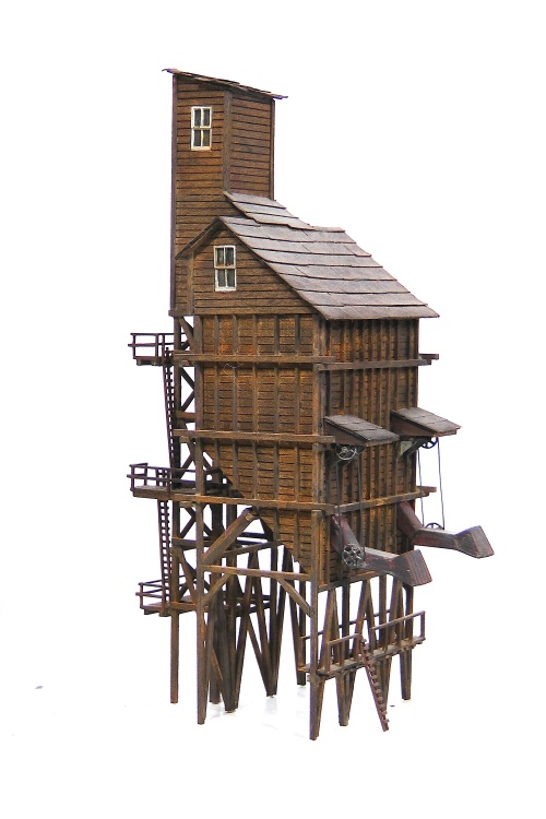 This is a wooden coaling tower, made I think, from the Campbell kit.  If it looks familiar to readers of this blog, that is because I built another one last year just like this on commission from a client.  I had forgotten all about building this one so many years ago.