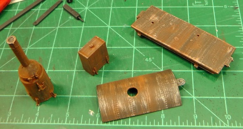 I dry brushed these parts with Model Master Steel colored paint, then brushed on Bragdon Weathering powders rust.
