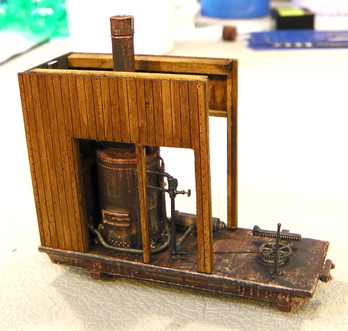 The model comes with three wooden sides which could completely enclose the steam bioler, but I opened up the two long sides so much of the detail would show.
