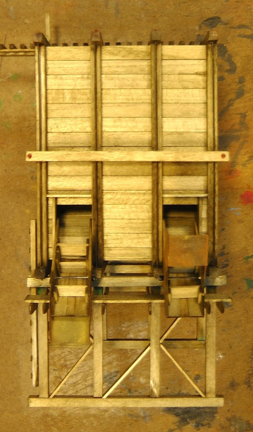 In this front view, you can see the bin chutes and their adjustable deflectors.  These last parts are just a heavy grade of paper, but they look like steel once they are painted and weathered.