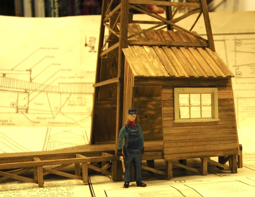 Here is an O scale figure next to one of the walls with an enlarged door opening, and a small O scale window.