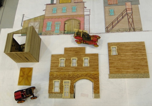 Work continues, slowly, on the Durango fire hall.  I'm using Monster Model Works new board siding on the sides and upper front floor.  The windows and shed doors are from Rusty Rails Rick.