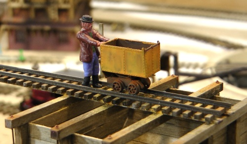 "This little figure, sometimes known as ""Cousin Jack"" comes from Grandt Line Products along with this hand-propelled tipping ore car."