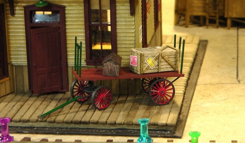 Another Grandt Line products with great detail is their depot baggage wagon kit, here assembled, painted and seen at my Silverton Depot.