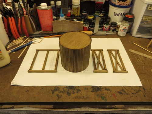 """I always stain my stripwood before assembly, and I use isopropyl alcohol with a few drops of leather dye.  I keep various colors of stain in plastic containers like the one in the background of this photo that is marked """"wire""""."""