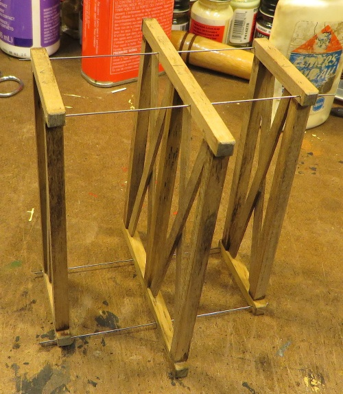 At this point I decided to drill the legs for the truss rods.  Keeping them all aligned really helped with subsequent construction.