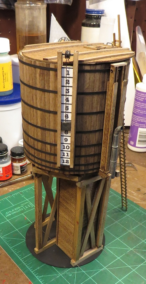 .....and another.  the end of the chain from the water level gauge will drop through a small hole in the tank top.  The marker on the numerical scale is actually suspended by that chain, but I glued it in a fixed position at the pulley.