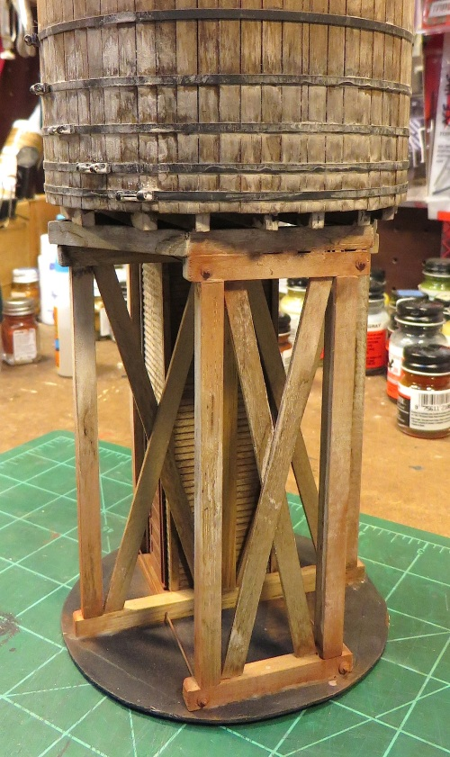 After the legs were positioned and secured, I cut the truss rods to length and used NBW castings on each end to hold them in place.  I used Bragdon's rust weathering powder wherever there were metal parts.