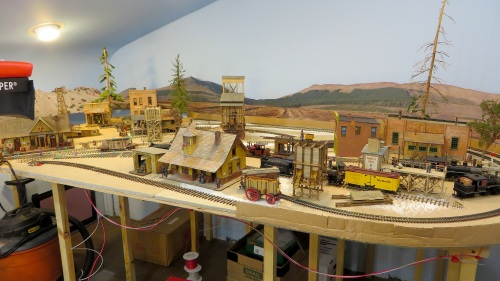 The Durango unit is still more or less a storage piece, although a lot of the track and structure locations are correct for future use.  Bringing Durango down some will also help with the transition to the photo backdrop.