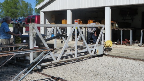 A transfer table allows visiting engines and rolling stock access to the railroad.