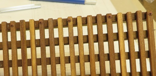 The instructions call for the bridge ties to be bolted every fourth tie, and in the center of the bridge.