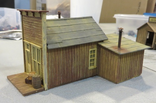 I have earlier posted plans to create forced perspective in some areas of my layout. The vast vendor display area at the Narrow Gauge Convention featured a number of booths with attractive kits in HO and S scales.