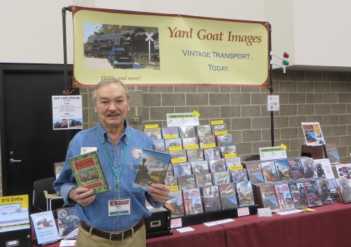 Last weekend I went with my friend, Steve Mitchell, to the Mad City Model Railroad Show in Madison, Wisconsin. I have sometimes shot video for Steve's DVDs, and I like to help him with these shows. I'm holding two of the videos that I did a lot of work on.