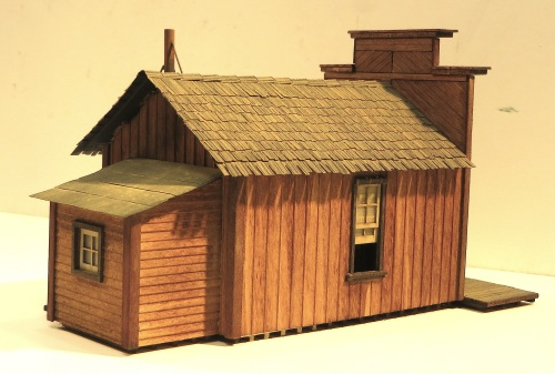 "This structure (front view above) is the Wild West Scale Model Builders S-scale Assay Office. The kit is lazer cut plywood and basswood, and the footprint is 6.5"" by 3.5""."