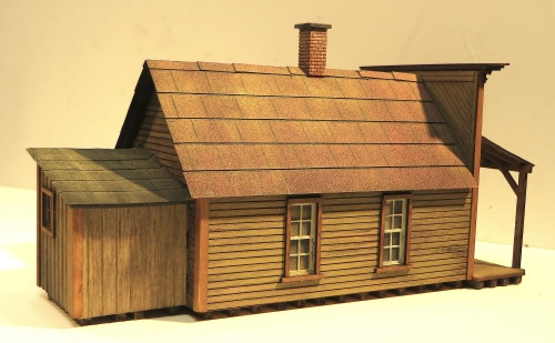 I used a thin-tipped permanent marker to add some detail to the tar-paper roofing material. I can also see that I need to add some chimney flashing.