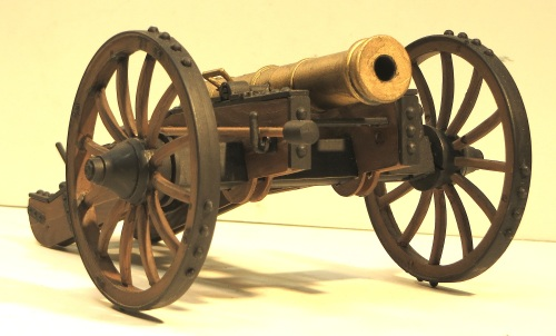 "This is another completely plastic kit by Encore Models for a revolutionary war cannon. Note the different painting techniques for wood, brass and iron. The scale of the model is 1:24 and measures about 8"" long by 5"" wide."