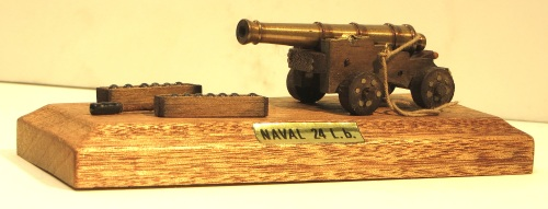 "Here is another version of a naval 24 pound cannon, this one by the Italian company, Artisania Latina. The scale was not specified, but the base on which the cannon rests is only 5"" long by 2.5"" wide. This presents the challenge of working on something which is so diminutive; the cannon balls in the boxes in front of the cannon are about the size of shotgun pellets."
